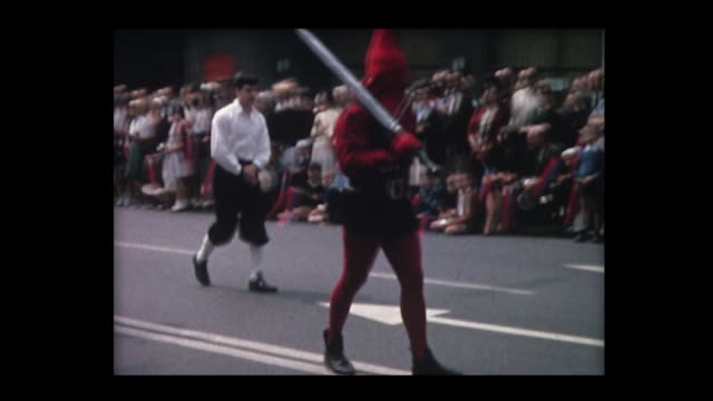 1964 swiss parade depicting historical periods in costume - historische kleidung traditionelle kleidung stock-videos und b-roll-filmmaterial