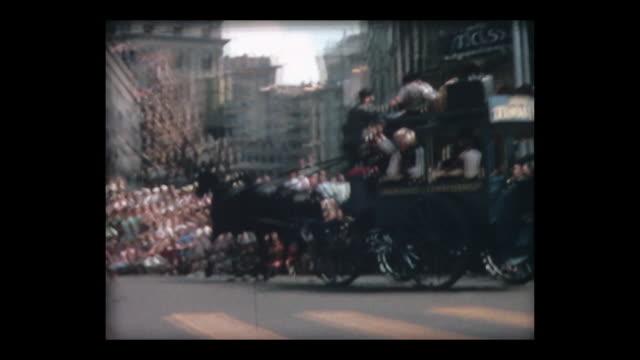 1964 swiss parade horse-drawn stage coaches - historische kleidung traditionelle kleidung stock-videos und b-roll-filmmaterial