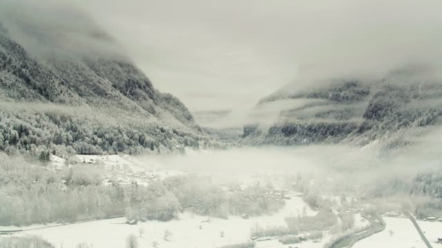 Swiss Valley In Mist and Snow - Drone Shot