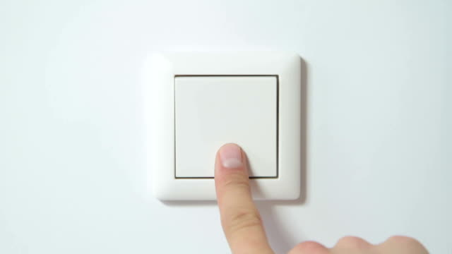switch on a white wall - close-up from front - light switch stock videos & royalty-free footage