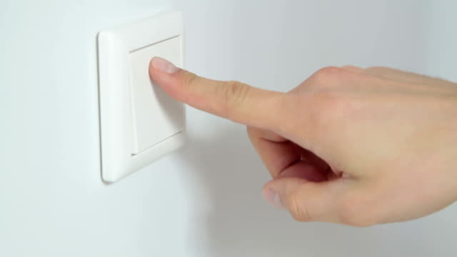switch on a white wall - different angles - light switch stock videos & royalty-free footage