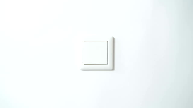 switch on a white wall - from front, centered - light switch stock videos & royalty-free footage