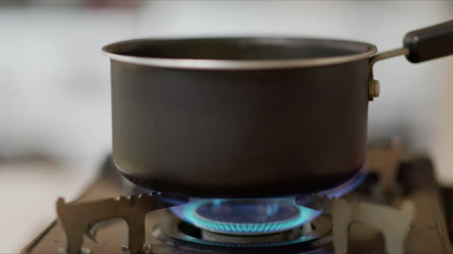 switch on stove - turning on or off stock videos & royalty-free footage