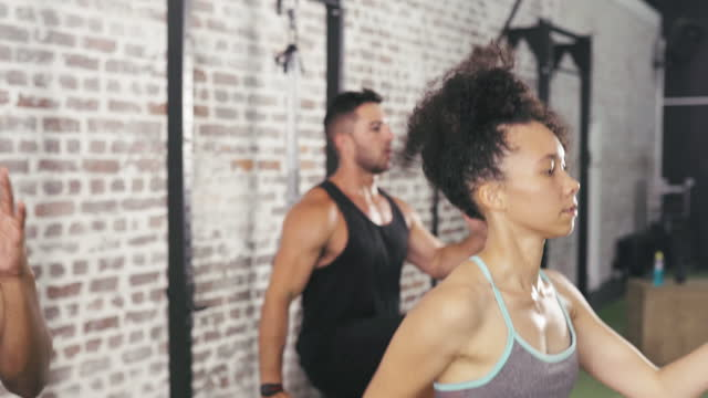 switch things up by joining a fitness group - bodyweight training stock videos & royalty-free footage