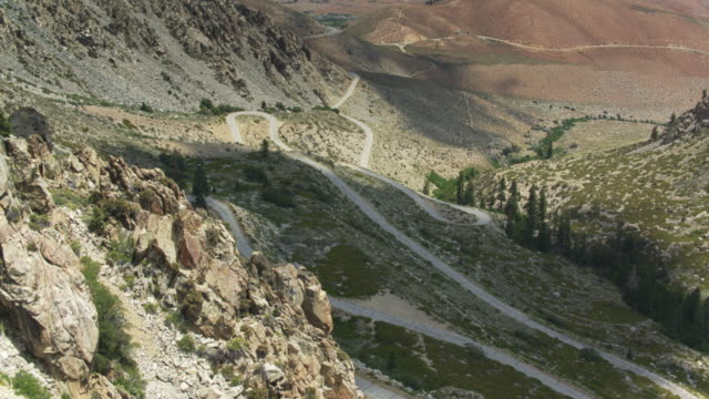 switchbacking road from the high sierra down into the owens valley - wilderness area stock videos & royalty-free footage