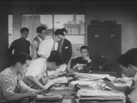 switchboard operators at central telephone exchange station/ close-up of typing at type machine/ office clerks/ telephone operators - file clerk stock videos & royalty-free footage