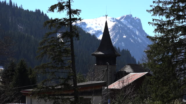 switzerland church steeple and mountain - steeple stock videos & royalty-free footage