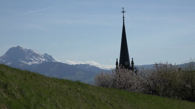 switzerland la gruyere view of alps beyond church steeple - steeple stock videos & royalty-free footage
