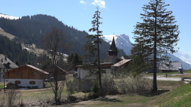 switzerland mosses church steeple and mountain - steeple stock videos & royalty-free footage