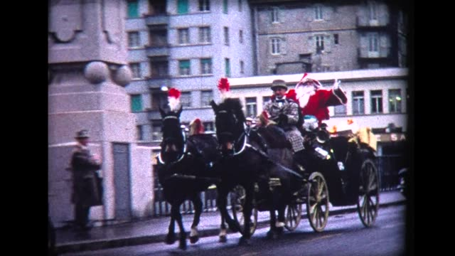 1967 switzerland - santa in horse-drawn carriage with police motorcycle escort - horsedrawn stock videos & royalty-free footage