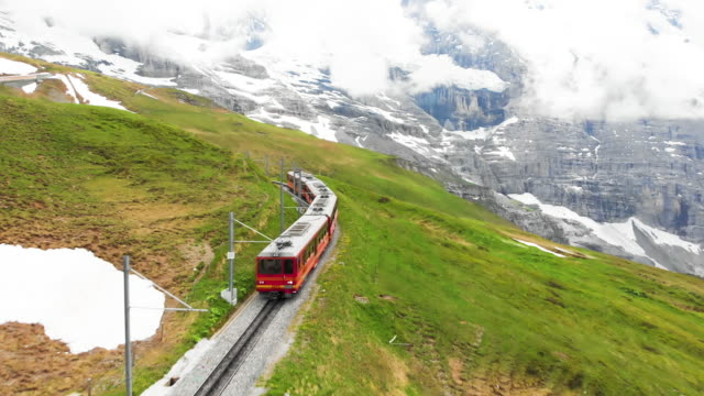switzerland train for transportation to travel in wengen - treno video stock e b–roll