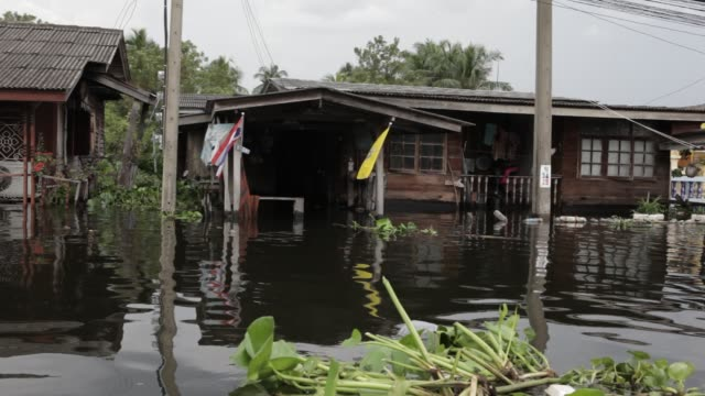 A swollen canal floods a residential area in the Nonthaburi district of Northern Bangkok Thailand Heavy monsoon rains have been drenching Southeast...