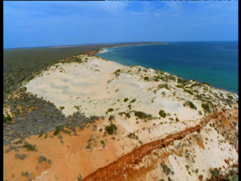 swooping track along red nullarbor cliffs of shark bay, western australia - image stock videos & royalty-free footage