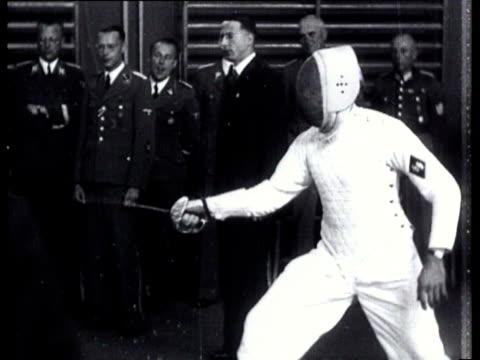 a swordplay tournament with rauter seyssinquart and schumann as guests - spada video stock e b–roll
