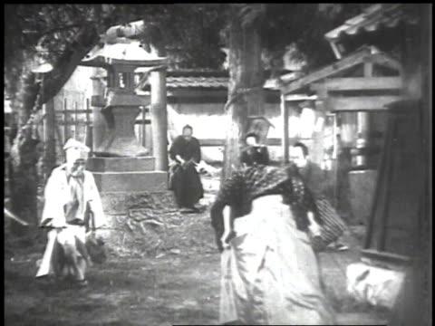 1939 ws swordsmen in costume sword fighting / japan - martial arts stock videos & royalty-free footage