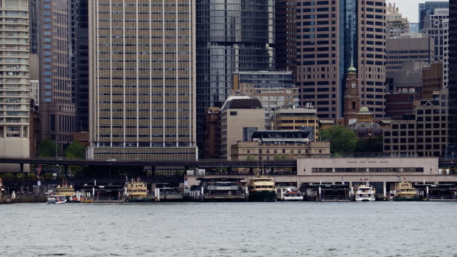 sydney circular quay with ferries on a cloudy day - steve munro stock videos & royalty-free footage