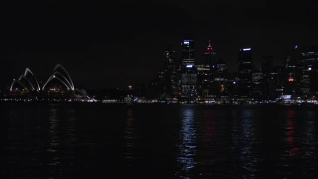 sydney city and opera house at night - steve munro stock videos & royalty-free footage