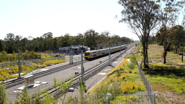 a sydney cityrail train heads citybound through a rural setting after leaving the edmonson park railway station in sydney's south west on november 7... - tramway stock videos & royalty-free footage