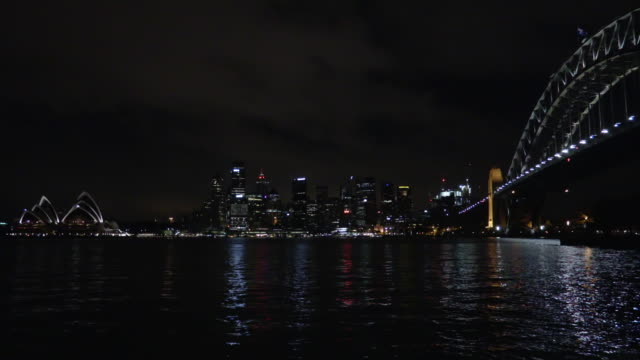 sydney harbour and city at night - steve munro stock videos & royalty-free footage