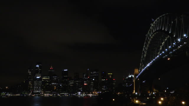 sydney harbour bridge and city at night - steve munro stock videos & royalty-free footage