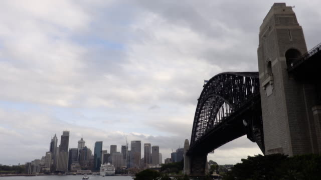 sydney harbour bridge and city on a cloudy day - steve munro stock videos & royalty-free footage