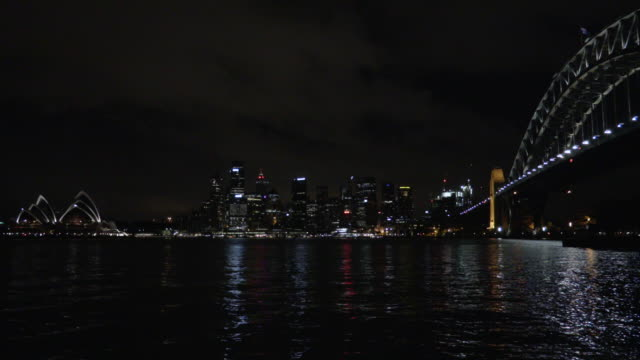 sydney harbour bridge, city and opera house at night - steve munro stock videos & royalty-free footage