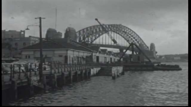 sydney harbour bridge in the back ground of circular quay wharf on western side various shots of the quay and wharf building being demolished... - imbracatura di sicurezza video stock e b–roll