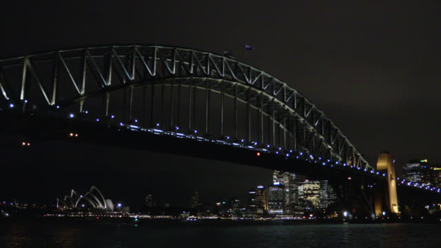 sydney harbour bridge with opera house at night - steve munro stock videos & royalty-free footage