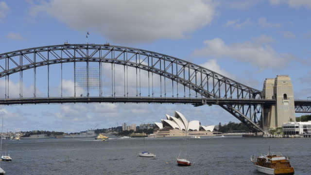 sydney harbour with opera house and harbour bridge with skyline in new south wales australia - establishing shot stock videos & royalty-free footage