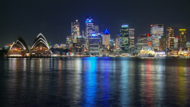 T/L WS Sydney Opera House and downtown cityscape at night / Sydney, New South Wales,  Australia