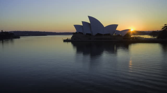 ws zi t/l sydney opera house and sydney harbour at sunrise / sydney, new south wales, australia - sunrise dawn stock videos & royalty-free footage