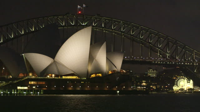 sydney opera house lit up at night - opera house stock videos & royalty-free footage