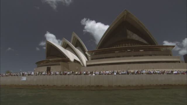 POV Sydney Opera House seen from Sydney Harbor, crowd gathering for Australia Day Parade, Sydney, New South Wales, Australia