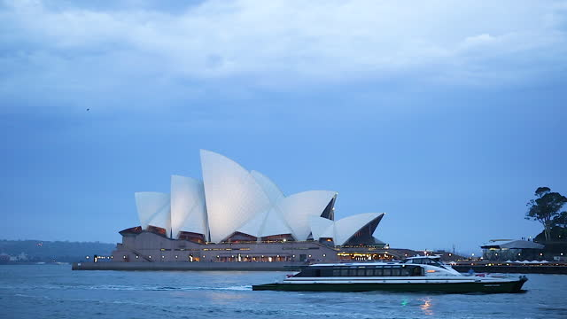 sydney opera house / sydney, australia - moody sky stock videos & royalty-free footage