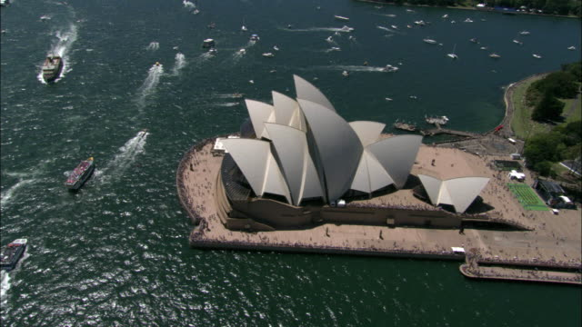 WS PAN ZI ZO POV AERIAL Sydney opera house with ferries in harbor / Sydney, New South Wales, Australia