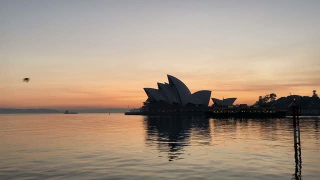 sydney opera house with smoke in background at sunrise on november 12 2019 in sydney australia more than 50 fires are burning across nsw with 200... - monday morning stock videos & royalty-free footage