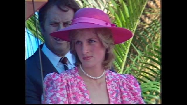 stockvideo's en b-roll-footage met prince charles and princess diana down steps raaf plane – greet official party / close up plane cockpit seeing pilots and royal flag / charles and... - 1983