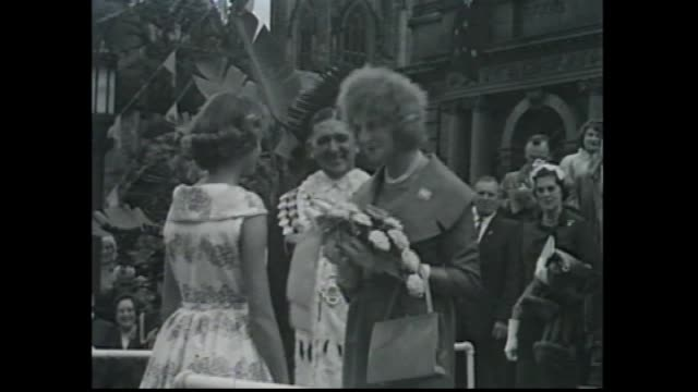 sydney town hall sydney lord mayor harry jensen in full regalia walks down steps with other officials / jensen greets the princess alexandra /... - 1959 stock-videos und b-roll-filmmaterial