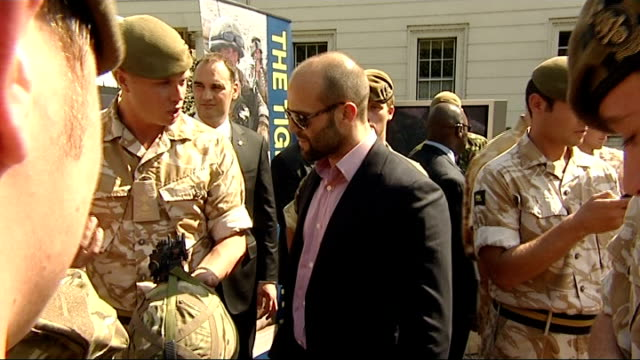 sylvester stallone meets british troops various of stallone being shown piece of artillery by soldier / various of soldier explaining to statham how... - bayonet stock videos & royalty-free footage