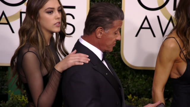 sylvester stallone model jennifer flavin and 2017 miss golden globe sistine stallon scarlet stallone and sophia stallone at the 74th annual golden... - ビバリーヒルトンホテル点の映像素材/bロール