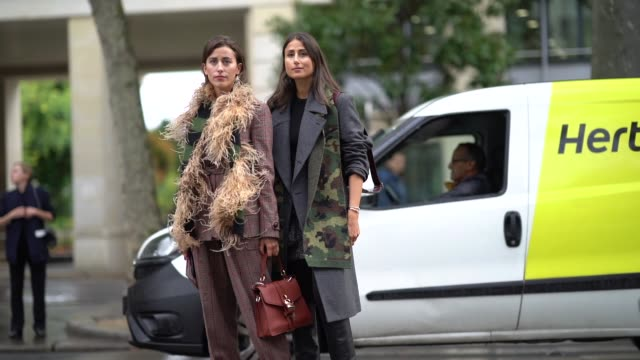 sylvia haghjoo wears a brown and burgundy prince of wales check jacket assorted baggy pants a black and green knit scarf decorated with feathers a... - grey jacket stock videos and b-roll footage