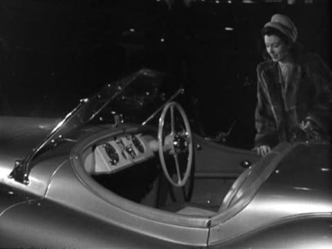 sylvia peters poses in a new sports car at the earls court motor show. - earls court stock videos & royalty-free footage