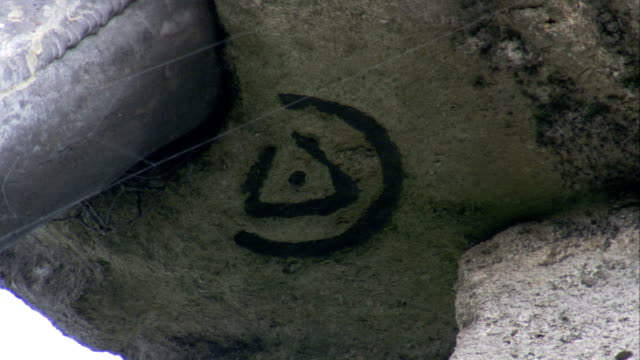 a symbol is engraved at the base of a stone gargoyle at rushton triangular lodge in northamptonshire, england. available in hd. - northamptonshire stock videos & royalty-free footage