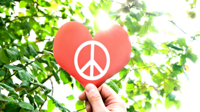 symbol of peace on heart shape - cnd sign stock videos & royalty-free footage