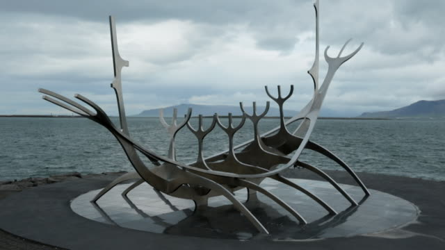 symbol of reykjavik, viking ship monument on the sea bank, iceland. - viking stock videos and b-roll footage