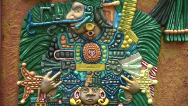 symbols, a headdress, and bright colors make up a mayan relief. - mayan stock videos & royalty-free footage