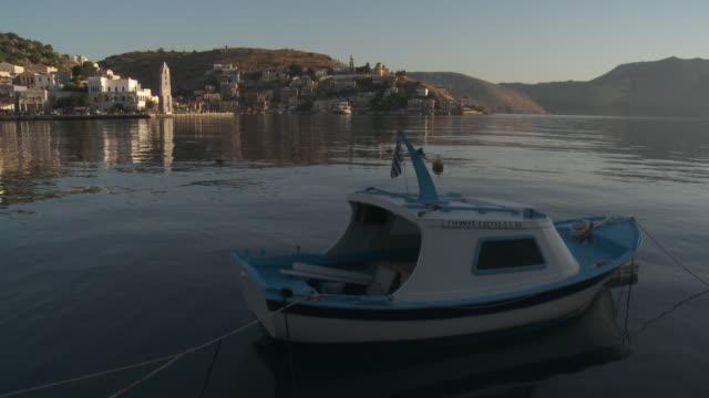 symi harbour at dawn - griechische flagge stock-videos und b-roll-filmmaterial