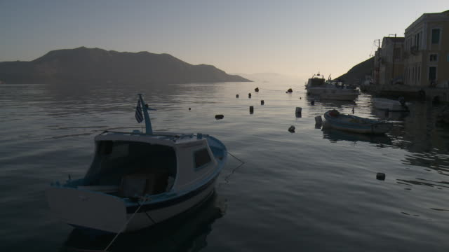 symi harbour at morning. - anchored stock videos & royalty-free footage