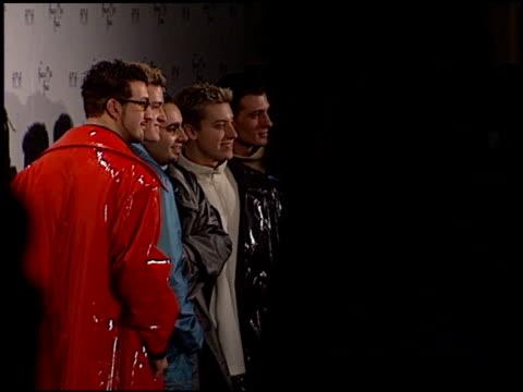 'n sync at the 1999 american music awards press room at the shrine auditorium in los angeles california on january 11 1999 - イン・シンク点の映像素材/bロール