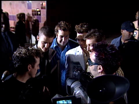 vídeos de stock, filmes e b-roll de 'n sync at the ''n syncbigger than live' premiere at imax theater california science center in los angeles california on march 30 2001 - n sync